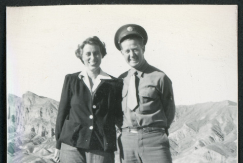Photograph of two people standing at Zabriske Point in Death Valley (ddr-csujad-47-114)