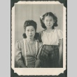 Seated woman and standing girl (ddr-densho-321-99)