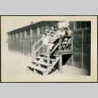 Group of male children on barrack stairs (ddr-csujad-32-19)