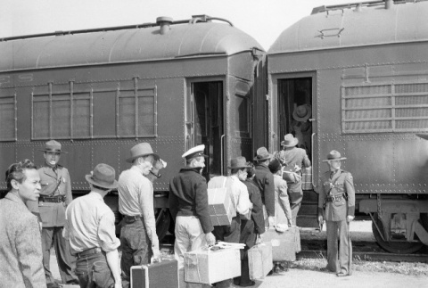 Indonesians boarding a train in San Francisco for the immigration detention facility at Crystal City, Texas (ddr-csujad-27-7)