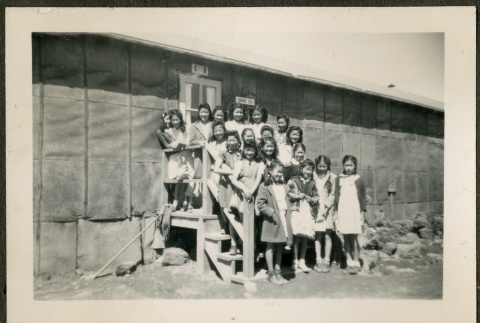 Group of female children on barrack stairs (ddr-csujad-32-17)