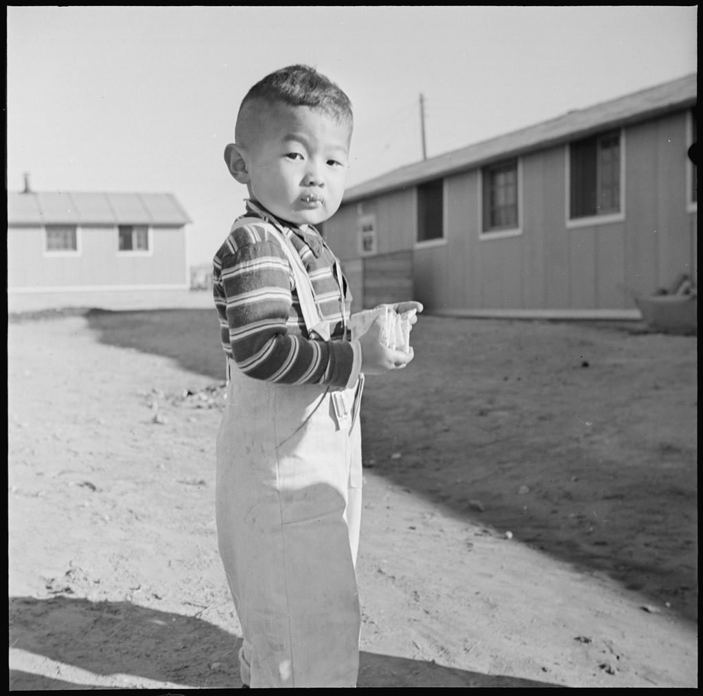 "photo essay colorado s amache concentration camp densho original wra caption ""granada relocation center amache colorado it is a long time between meals at the mess hall for a hungry man so the cracker box at"